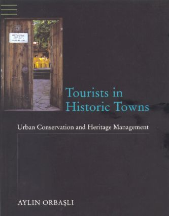 Tourists in Historic Towns: Urban Conservation and Heritage Management, 1st Edition (Paperback) book cover
