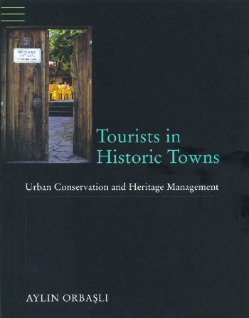Tourists in Historic Towns Urban Conservation and Heritage Management book cover
